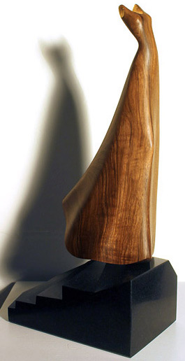 Anna Korver nz wood and stone sculptor, walnut, gold foil